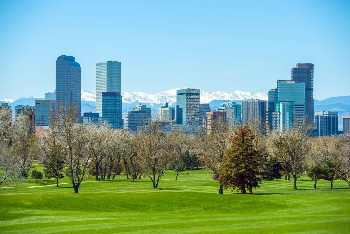 Denver city skyline with the Rocky Mountains in the background